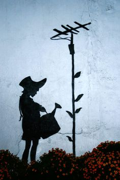 Banksy LA 2008  Banksy's silhouette graffiti was inspirational towards the evolution of representing our images in a mixed portraiture of silhouette and in profile.