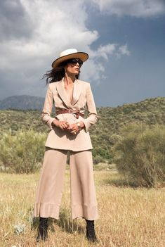 Soft, modern cotton drill tailoring inspired by the courageous female explorers of the 20th century. Discover the Margot jacket and trousers by Alice Temperley. Styled with the Andalusian Panama from Lock Hatters and Zanzan sunglasses