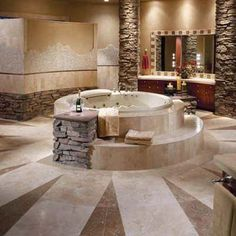 Torreon Classic Travertine and Mexican Noce Travertine.  A bathroom you might never want to leave! Designed obviously for a large space, but the stone on the walls and the spa and the round spa placed in the center of the room can be reproduced in smaller spaces.