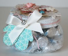"winter gift jar from lisadorsey.blogspot.com  (I'd change up the mittens for something else seasonal--shells for summer, etc--- and add the ""hugs and kisses"" candy--would be great for wedding favors as well."