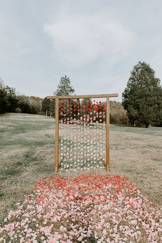 Modern Ombré Wedding Style ~ ombré petals on the grass and hanging from the ceremony backdrop