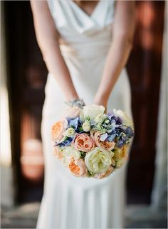 Classic Bouquet ~ lighter blue hydrangeas with peach garden roses, ivory & yellow garden roses, few light ivory spray rose buds  so you may see these colors together  The hydrangea would be a lighter blue