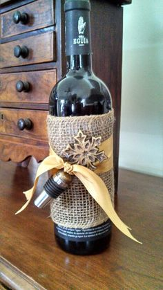 Burlap, ribbon, and a pretty wine stopper to dress up a bottle of wine.