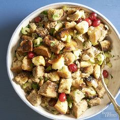 There are two standouts in this garlicky stuffing. First, a combo of rustic white and whole wheat bread gives it tons of texture. Second, fresh colorful cranberries cut through the richness.