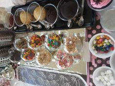 cupcake bar... Love that idea of cupcakes in the plastic cups easy to eat with all the goodies kids put on them