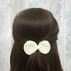 This eye-catching white bow hair clip features a hand knitted, luxurious Egyptian cotton bow that will complete any outfit with whimsical style - from dressing up a casual t-shirt and jeans look to finishing off your look for a night out on the town. The bow has a lustrous silky sheen making this a great accessory for special occasions like weddings and proms. The French barrette clip on this accessory is suitable for older girls, teens and women. This makes a lovely little gift too!  If…