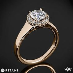 This Solitaire Engagement Ring is from the Ritani Bella Vita Collection.  It features a circular 4-Prong halo that holds a round diamond center of your choice and shines with Round Brilliant Diamond Melee (0.10ctw