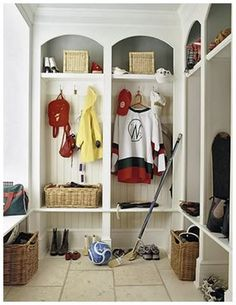 mud room arched cubbies. I like that they photographed this in a messy state.   Open storage below bench