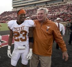 Carrington Byndom (23) and Texas Football head coach Mack Brown