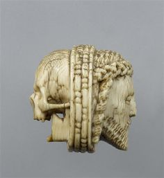 Ivory paternoster bead with Christ's head and a death's head, 16th century