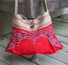 I made this pleated purse in a red bandana and jute/burlap webbing. Who knew a bandana could be so fashionable? This is my best boutique seller. Bandana is red with black and white print. This purse...