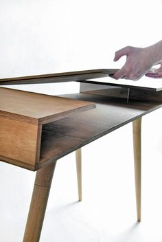 I'm loving this solid wood desk by designer Shpelyk Roman. With a swinging top level and two planes to work on, it achieves the functionality of
