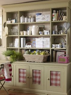 country hutch with chicken wire covered cutouts