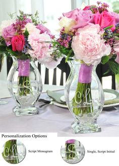 DIY glass etched vases Personalized with Bride and Grooms initials for centerpieces on the reception tables. Adding colored water to match the theme would really be even better.