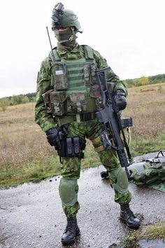 Lithuanian Special Operations Force (LITHSOF) operative with a Heckler & Koch G36 assault rifle.: