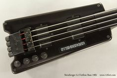 This 1982 Steinberger L2 Fretless Bass, number 466, is in great condition, with all the parts. As a fretless, it is not a conversion, but a factory fretless model. It has two EMG active pickups and four controls. It uses double ball end strings, and features the breakthrough bridge and tuner tailpiece.