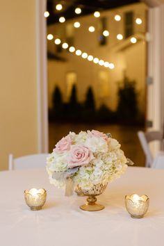 Blush centerpieces in gold mercury glass containers and tulip candle votives. CD florals is fantastic! The Sonnet House | 205 Photography