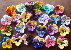 A set of 25 hand crochet from cotton mercerised thread pansies in bright colours