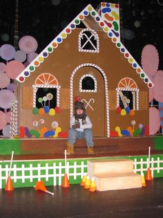 Gingerbread house, kids' art as the candy? and use for christmas play?