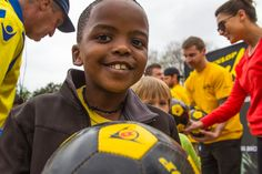 Smiles all round as one of the pupils from Weenan Primary School receives a free Dunlop soccer ball
