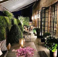 Summer style!! HOT TREND!! Seeing more ways to cover a balcony, deck, patio, terrace, veranda, porch! BLACK AND WHITE striped Awning covers a very elegant porch veranda terrace!
