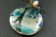 Teal Paris Locket Necklace. Eiffel Tower Necklace. Paris Necklace with Teal Teardrop and Pearl. Eiffel Tower Locket. Handmade Jewelry. by StumblingOnSainthood from Stumbling On Sainthood. Find it now at http://ift.tt/2d6eABe!