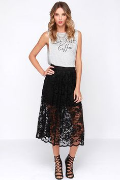 Craving a bit of adventure? See what the night has in store for you when you step out in the Evening Escapade Black Lace Midi Skirt! A layer of sheer black lace falls from a high-waist (with woven waist band), boasting a lovely floral design with swirling accents. The black stretch knit lining beneath ends at a sassy mini length, showing off just a bit of leg under the sheer lace that ends at a charming scalloped hem. Hidden side zipper with clasp. Lined to mid-thigh. Self: 60% Nylon, 35%…