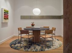 Modern Dining Room - modern - dining room - san francisco - Jennifer Gustafson Interior Design. NOT COZY, BUT NICE RUG AND LIGHT
