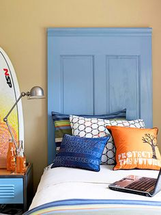 Here's a knockout idea for a headboard in a kids room!  Purchase a plain pine door from a home center (new or secondhand), paint the door, and top with molding. How cool is that?