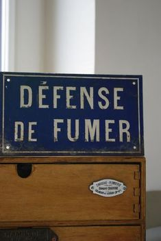 French Do not smoke sign: finding more vintage French signage in the language of Henry's Parisian street sign could be cool as an accent perhaps near the door?