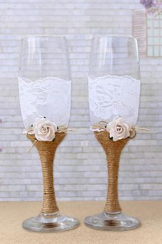 The jute twine wrapped around the stems of these toasting glasses actually looks elegant with the lace! Love the roses, too.  (scroll down to #14 on the page). #MyOnlineWeddingHelp