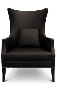 Love a Solid Black Chair in a bright room, keeps things from getting too frilly