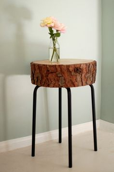 Awesome table made from upcycled bar stool metal legs and a slice of tree trunk for the table top.