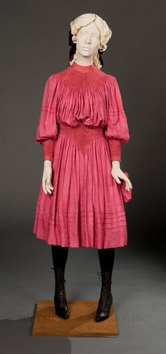 A bright pink girl's dress made between 1893 and 1897 by Liberty & Co. of London, one of the greatest promoters of the Aesthetic Dress movement.