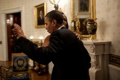 President Barack Obama dances with First Lady Michelle Obama in the Blue Room