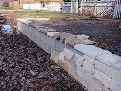 Stone seating wall with cinder block and stone façade (facade)