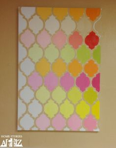 """DIY canvas stencil art with """"ombred"""" paint colors."""