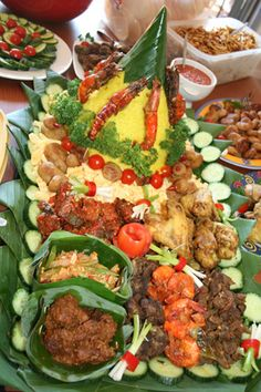 """It's called """"Nasi Tumpeng"""". The shapes of the rice is seems like a mountain. So magnificent!!"""