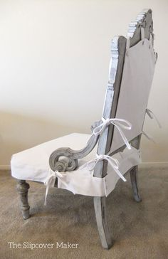 Two piece apron-style slipcover custom made in white chino twill for antique chair.