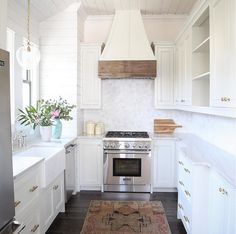 Small White Kitchen. Tons of storage makes this small white kitchen super functional. Small White Kitchen. Small White Kitchen #SmallWhiteKitchen #SmallKitchen Old Seagrove Homes