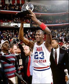 Michael Jordan in Chicago, 1988 All-Star game MVP. This is a nice pictures with Jordan's dad on the left with striped sweater.