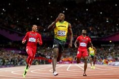 Usain Bolt races to victory in the men's 100-meter final. (Getty Images)