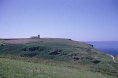 """""""The Parish Church of St. Materiana, in its solitary location on an exposed promontory scourged by Atlantic storms, seems remote from modern Tintagel, a throwback to some former pattern of village life. Tintagel Cornwall, British Countryside, Secret Places, Atlantic Storms, Medieval, Remote, Saints, The Past, Novels"""
