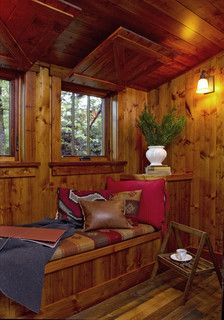 Cabin Nook for Relaxing. I love how the storm shutters flip up to ceiling.