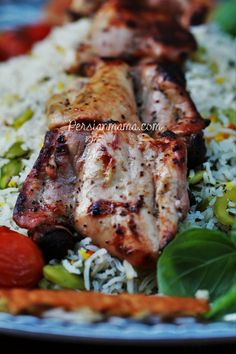 Grilled marinated chicken thighs is another method of making Persian joojeh kabob. Boneless, skinless thighs are marinated in a simple onion, lemon juice and vegetable oil mixture and then threaded on skewers