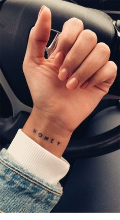 Nude nails and a nice tattoo