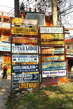 """Guest house signs Pokhara Nepal"" by jbobo | Redbubble"