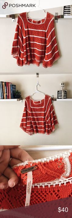 Free People Knit Top I'm so in love with this top, it's so beautiful. Perfect condition. 🍑 This is more orange than red!🍑It's a flowy, poncho type knit top with large arm holes. It's so cute and is the perfect piece to get you ready for spring and summer! It's an XS, and I usually wear a Small or Medium and this is how it fits me. (See photos). So it's meant to be oversized but could definitely fit XS-M. No Trades! Bundle for 20% discount! Free People Tops