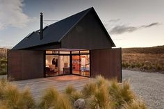 C Nott Architects Ltd, Tekapo, NZ This simple bach dwelling for a young family of four offers outstanding views and retreat on a hillside site. The architecture is strong and well-managed: a well proportioned gable form, simple materials, no-fuss. Architecture Durable, Residential Architecture, Interior Architecture, Black House, Cabana, Building A House, Shed, Villa, Cottage