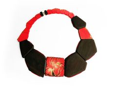 Flora Vagi Necklace: Red Rockrose Ebony, acrylic paint, 18ct gold, silk, wood